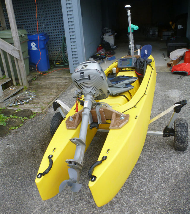2hp outboard motor mounted on fishing kayak
