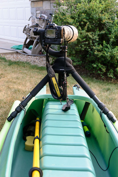camera tripod mounted on stable kayak for photography