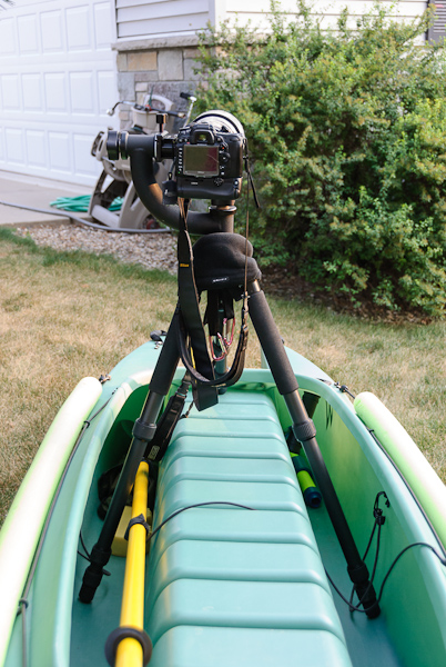camera with telescopic lens mounted on stable kayak for photography (2)