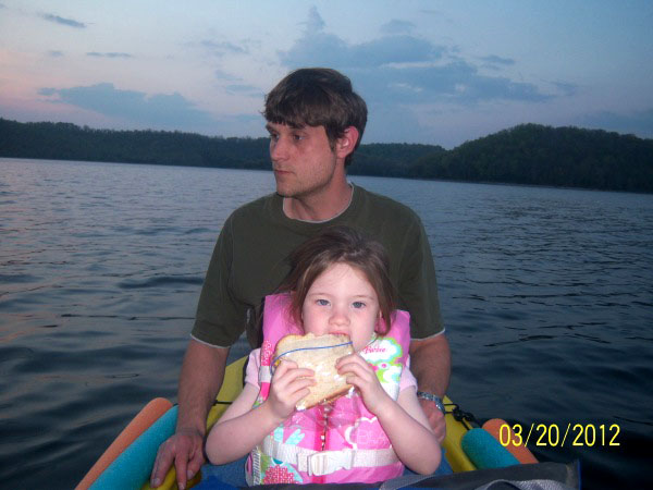 father and daughter in W fishing kayak, Tennessee