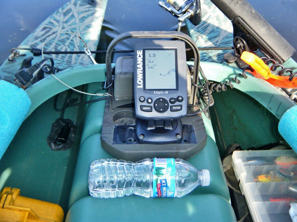 fishing kayak rigged with fish finder and transducer in bottom of hull