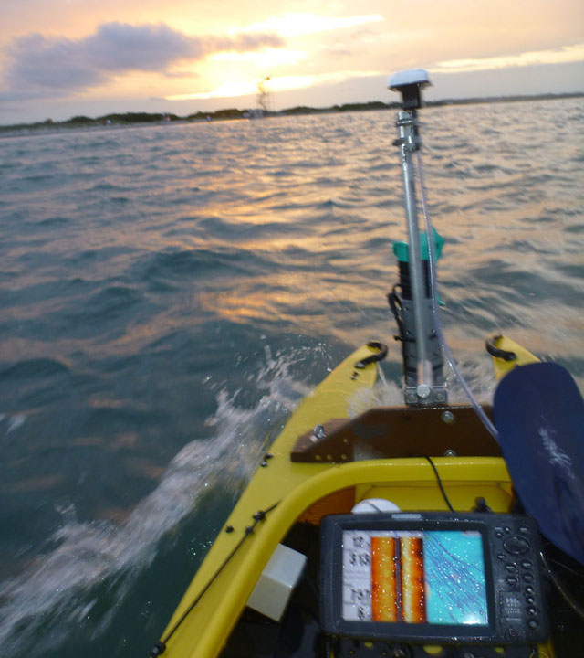 motorized fishing kayak ploughing the waves with scientific gear mounted in front (2)
