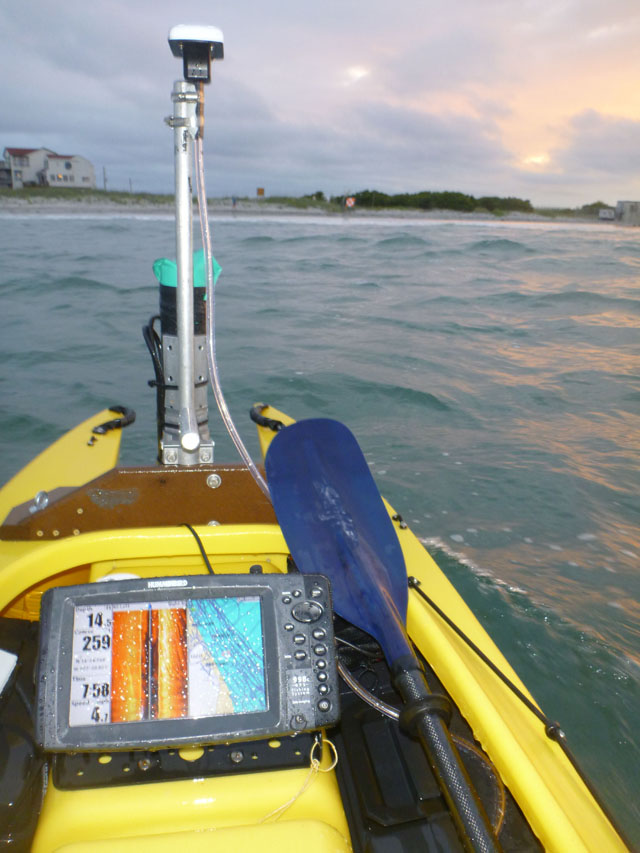 motorized fishing kayak ploughing the waves with scientific gear mounted in front (3)