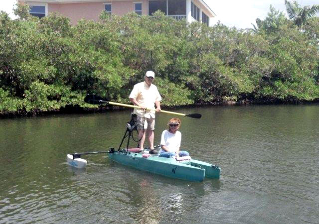 paddling a stand up fly fishing kayak with passenger on board (2)