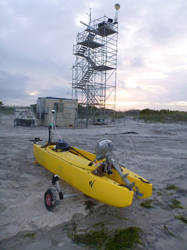 rear view of motorized fishing kayak with scientific instruments - on the beach