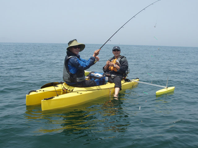 Kayak fishing in tandem in the ocean