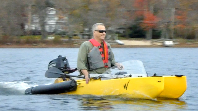 fisherman-driving-motor-kayak-640