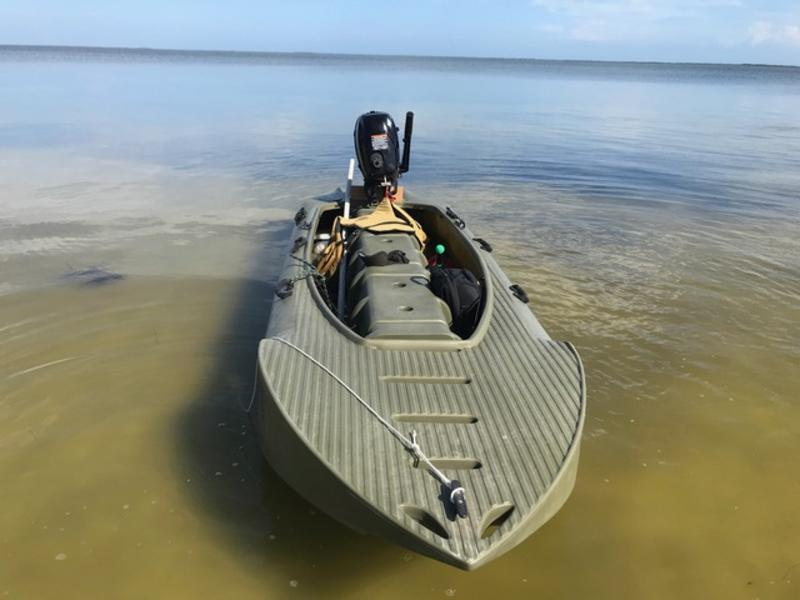Green S4 with outboard motor