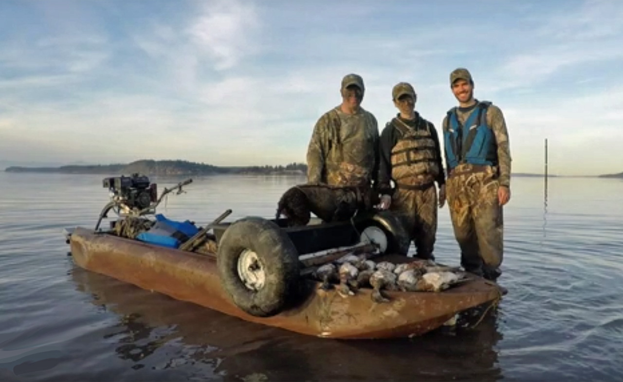 Duck hunters standing next to a Wavewalk S4